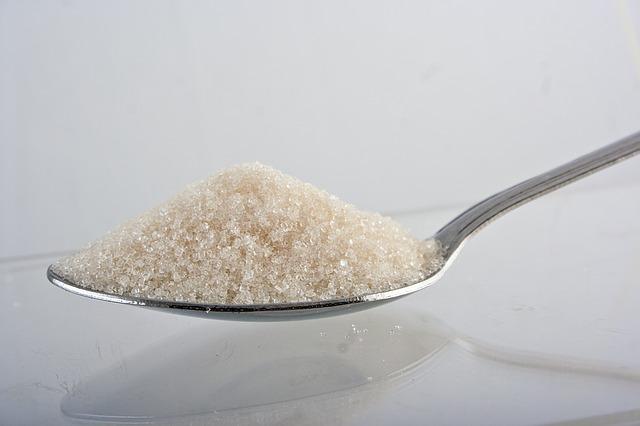 Zucker auf Loeffel